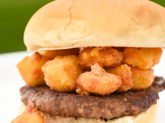 The new Cheese Curd Burger shown Wednesday, May 23,