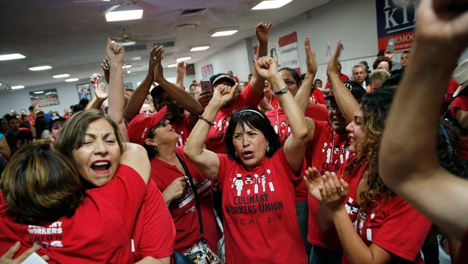 Latina voters celebrate primary election results in Las Vegas.