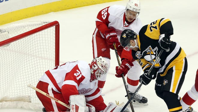 Red Wings goalie Jared Coreau makes a save against Penguins right wing Patric Hornqvist.