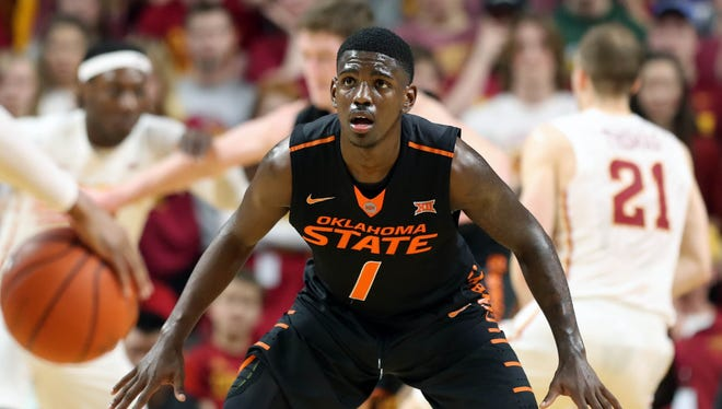 Feb 28, 2017; Ames, IA, USA; Oklahoma State Cowboys guard Jawun Evans defends against the Iowa State Cyclones at James H. Hilton Coliseum.