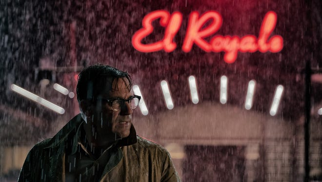 """Laramie (Jon Hamm) gets caught in the rain in """"Bad Times at the El Royale."""""""