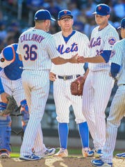 Jul 7, 2018; New York City, NY, USA; New York Mets manager Mickey Callaway (36) takes out pitcher Steven Matz (32) in the seventh inning against the Tampa Bay Rays at Citi Field.