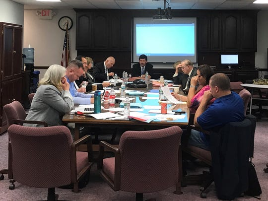 Toms River Board of Education member Dan Leonard of Beachwood (second from left) said he will step down from the nine-member panel on Dec. 31, 2017.