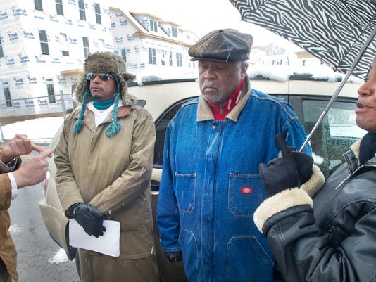 W. Craig Zumbrun, left, deputy executive director of the York Housing Authority, talks with Sandra Thompson, right, president of the York Branch of the while  NAACP while participants in the Community March In Support of Economic Fairness and Inclusion listen between them Monday March 25, 2013.  YORK DAILY RECORD/SUNDAY NEWS - PAUL KUEHNEL