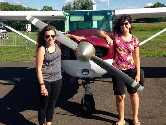 Reporter Jenna Intersimone (left) and flight instructor