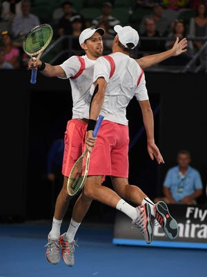Camarillo's Bob Bryan (right) and Mike Bryan celebrate their victory over Spain's Pablo Carreno Busta and Guillermo Garcia-Lopez in their men's doubles semifinal match at the Australian Open in Melbourne on Wednesday.