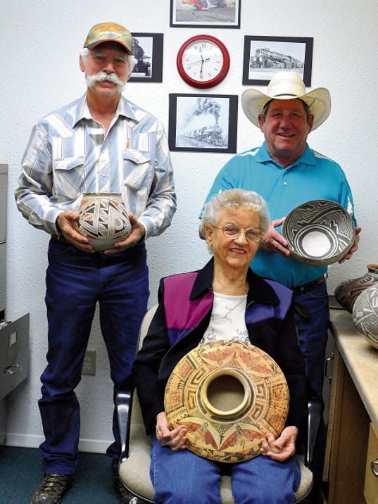 Courtesy Photo   A new collection of eight Southwest Native American pottery pieces have been donated to the Deming-Luna-Mimbres Museum by Ed and Betty Harris from Chicago. Local resident Bobby Smrkovsky friends with the Harris family personally delivered the pottery to the museum. From left: Stanley Stevens, Thelma Pelayo and Bobby Smrkovsky.