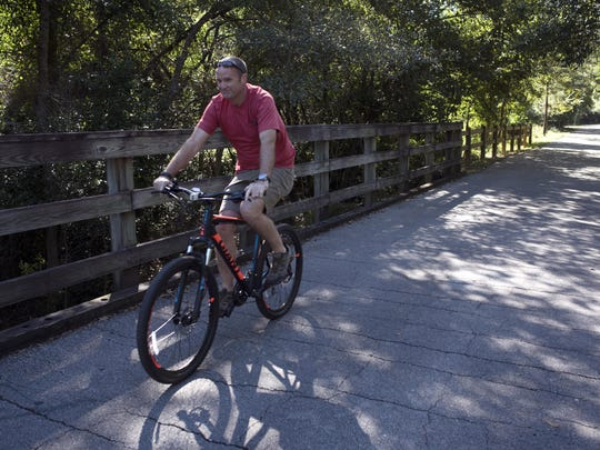 The Blackwater Heritage State Trail is a popular biking, hiking and walking path in the heart of Milton, Fla. The trail follows the abandoned railbed of the Florida and Alabama railroad.
