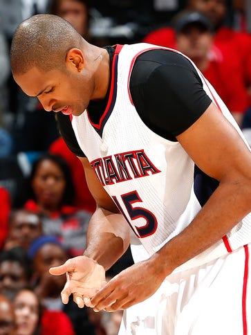 Al Horford of the Atlanta Hawks grabs his finger after