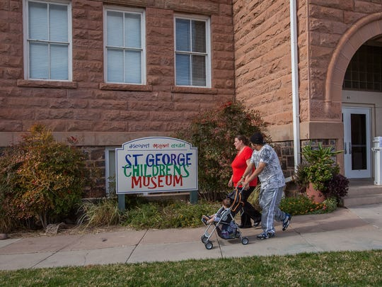 Brendon and Angel Messmer leave the St. George Children's Museum with their son, Caiden, on Thursday, November 21, 2013.