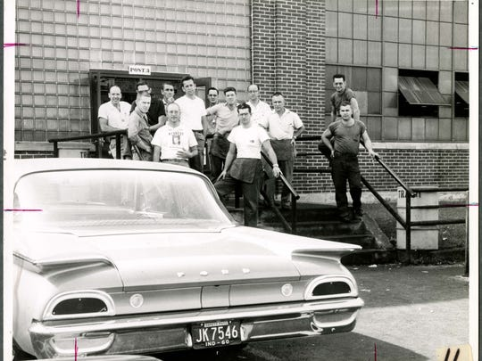 Warner Gear workers at a door to the plant in 1960.