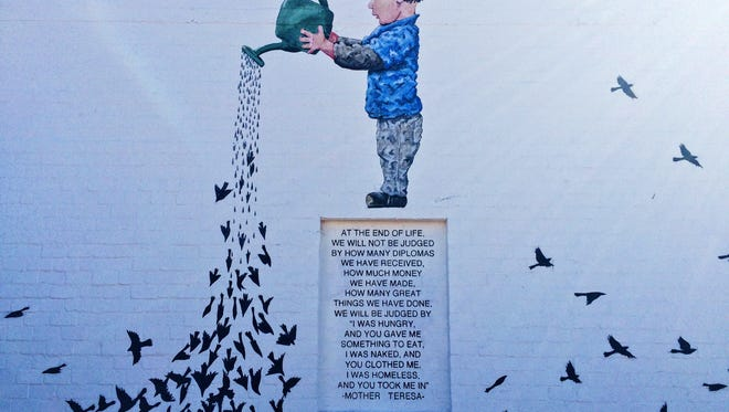 """""""The Garden"""" is a mural on MonOrchid dedicated to the homeless who have perished on the streets."""