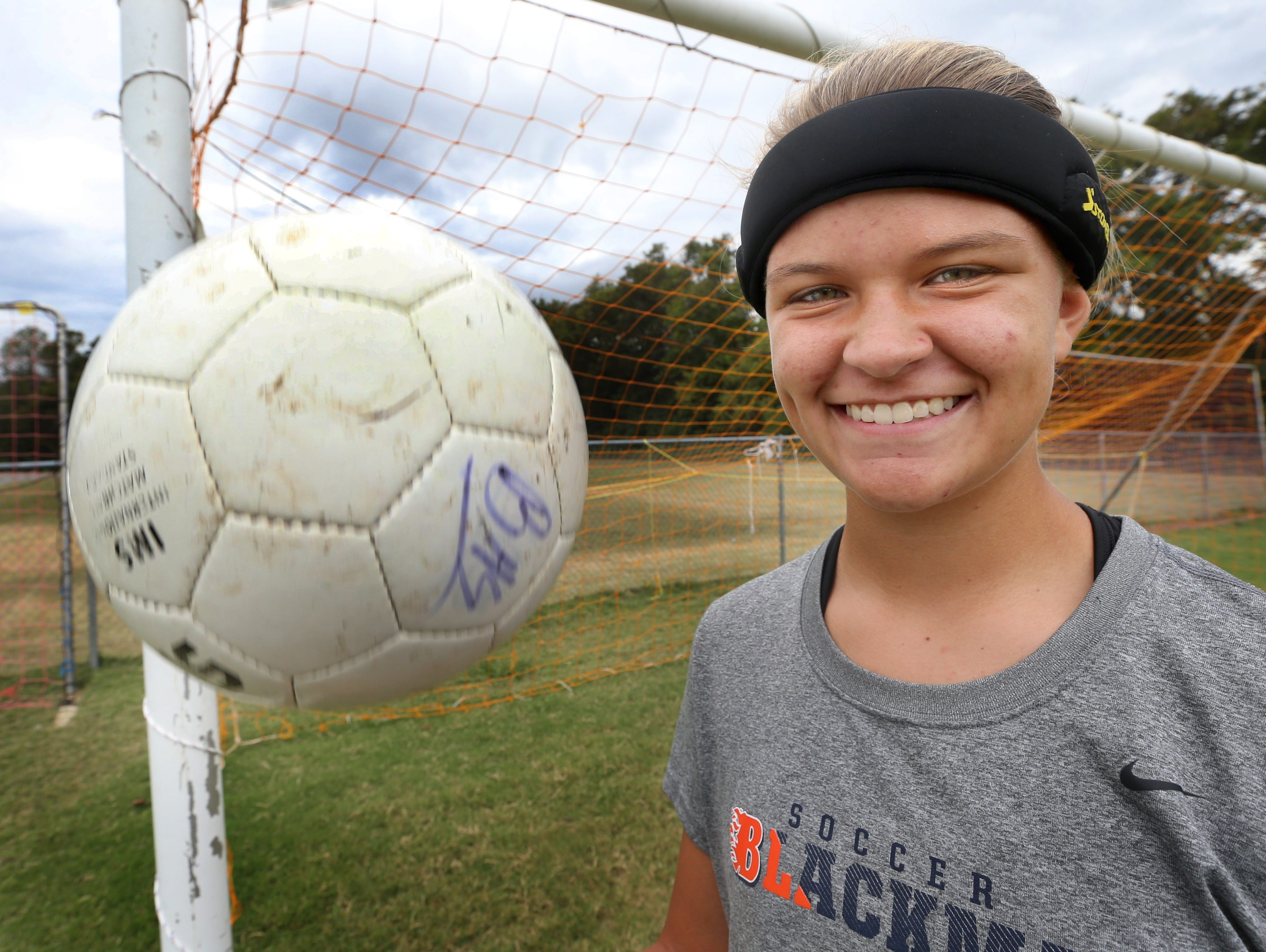 Blackman's Kenzi Vetter, a sophomore, models the headband that all Blackman girls soccer players must wear before getting on the field for either a game or practice, on Monday, Sept. 28, 2015, before a game against Smyrna. The headbands are suppose to lessen the chances of receiving a concussion.