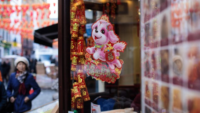 A dog decoration sits in the window of a restaurant in Chinatown ahead of Chinese New Year tomorrow on February 15, 2018 in London, England.