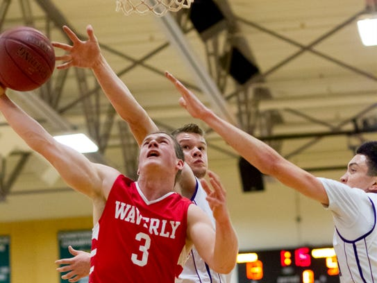 Waverly's Peyton Miller looks for a shot as Dryden's