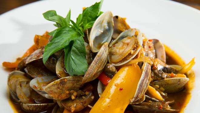 Pad hoy line, littleneck clams with sweet peppers in a spicy white wine sauce, is an entree at AppeThai, 3900 W, Brown Deer Road in Brown Deer.