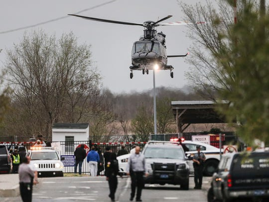 Rapper Meek Mills leaves in a helicopter from a nearby