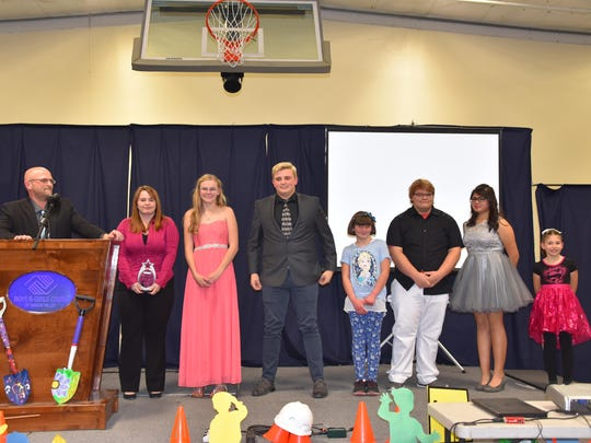 Boys and Girls Clubs of Mason Valley Chief Professional Officer Travis Crowder recognizes honorees Shelby Rosebush, Allyson Preston, Spencer Crowder, Ravena Smith, Jared Smithson, Marlene Herandez and Karina Davalos at the BGCMV Youth of the Year Awards Banquet Saturday in Yerington.