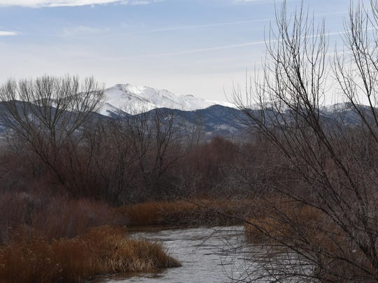 Mt. Grant, in the distance, looks out over the East Walker River at the Rafter 7 Ranch Sunday afternoon.