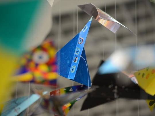 """The fifth annual Art Meets Heart community art project sits in the grand lobby of the Austin Straubel International Airport in Ashwaubenon. This year's project is called """"Creativity Soars."""""""