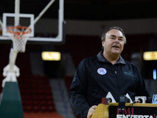 Brad Toll of the Greater Green Bay Convention & Visitors Bureau speaks about local impact of the upcoming WIAA girls basketball tournament Wednesday on the floor of the Resch Center in Ashwaubenon.