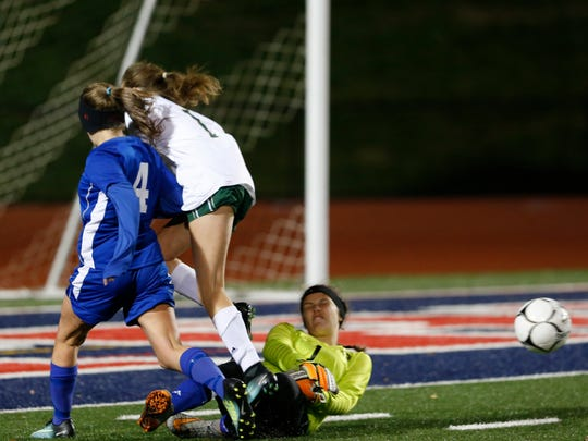 Maine-Endwell's Meghan Swartz saves a shot from Vestal's Emilia Cappellett during Thursday's Section 4 Class A final at Binghamton on October 26, 2017.
