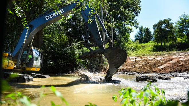 An employee of Aquatic Resource Restoration Company works in the Quittapahilla Creek on Tuesday, Aug. 30, 2016. The company is finishing up phase two of the bank restoration project which started in June. The Lebanon Valley Conservancy and the Quittapahilla Watershed Association received a $422,462 Growing Greener Grant from the Pennsylvania Department of Environmental Protection.