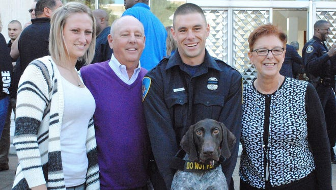 From left to right, Nikki Salgot, Randy Rose, Collin Rose, canine Wolverine and Karen Rose. Collin Rose shared a home with Salgot, who shares his passion for dogs. Karen and Randy Rose are Collin's parents.