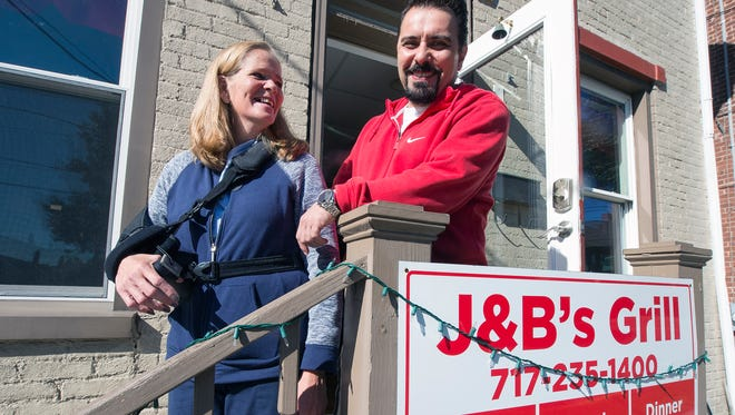 Jodi Hogue, left, and her husband, Burcin Topuz, are owners of J&B Grill in Shrewsbury.