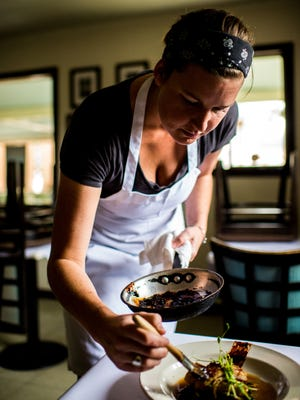 Ashley Roussel, executive chef of the Saint Street Inn in Lafayette, plates a dish of Miso Gulf Fish on Saturday, Oct. 31, 2015.