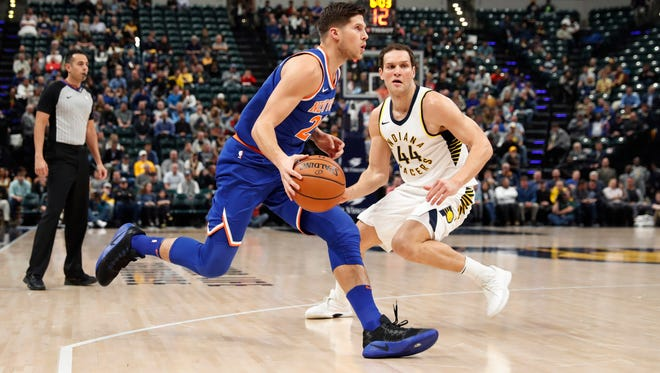 New York Knicks forward Doug McDermott (20) prepares to shoot the ball in front of Indiana Pacers forward Bojan Bogdanovic (44) during the first quarter at Bankers Life Fieldhouse.