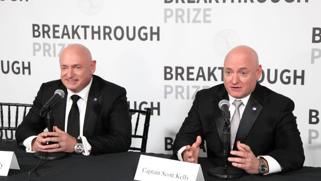 Astronauts Mark and Scott Kelly speak during the 2017 Breakthrough Prize at NASA Ames Research Center on December 4, 2016 in Mountain View, California.