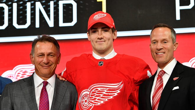 Filip Zadina poses with GM Ken Holland, left, and owner Chris Ilitch, after being selected as the No. 6 overall pick by the Detroit Red Wings in the first round of the 2018 NHL Draft on June 22.