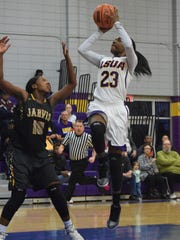 LSU at Alexandria's Pearl Paulo (right) shoots over Jarvis Christian College's Lamia Frazier-White (10, left) Thursday.