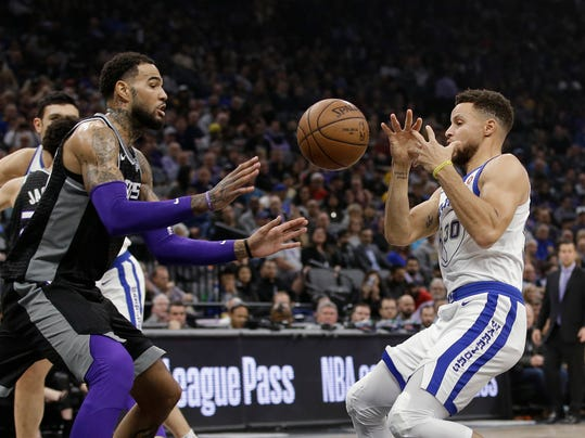 Sacramento Kings center Willie Cauley-Stein, left, and Golden State Warriors guard Stephen Curry go for the ball during the first quarter of an NBA basketball game Friday, Feb. 2, 2018, in Sacramento, Calif. (AP Photo/Rich Pedroncelli)