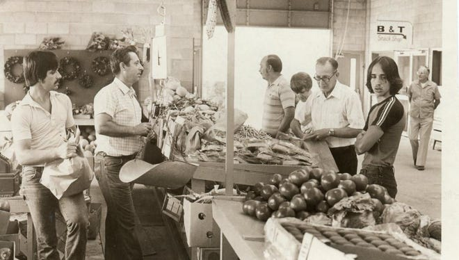 Customers look for produce at the WNC Farmers Market in 1982.