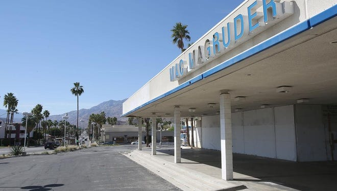 The shuttered Mac Magruder dealership sits on a very visible spot of South Palm Canyon Drive at Mesquite in Palm Springs.  The business has been closed for years and neighbors would like to see the sight developed.