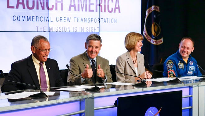 From left, NASA Administrator Charles Bolden, Kennedy Space Center Director Bob Cabana, Commercial Crew Program Manager Kathy Lueders and Astronaut and former International Space Station crewmember Mike Fincke, announce NASA's choice of Boeing and SpaceX to ferry astronauts to the International Space Station during a news conference at the Kennedy Space Center Sept. 16, 2014, in Cape Canaveral.