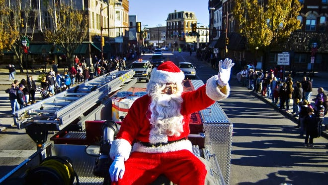 Santa Claus waves to the crowd as he arrives in downtown Hanover Friday during a past Hanover Christmas parade.
