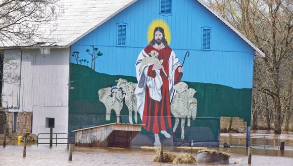 "Even a mural of Jesus was affected by the Detter's Mill flooding in 2011. ""It's the first time he has gotten in the water, instead of walking on it,"" John Yost said at the time, referring to the mural on his property in Dover Township."