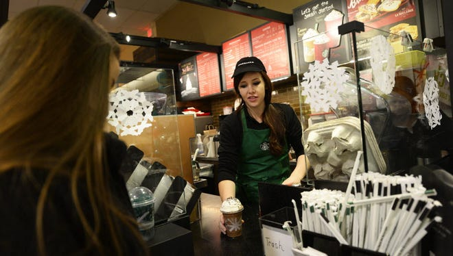 Amy Gehris makes a drink for a customer at Starbucks in Giant in York Township on December 10, 2014.