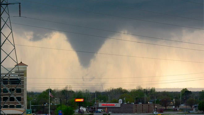 A funnel cloud forms over Tulsa, Okla., on March 30, 2016.