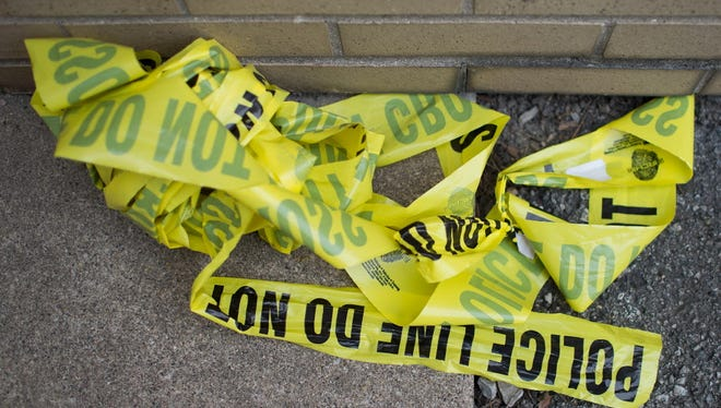 Remnants of crime scene tape remain on the ground in Foster Park following a shooting on April 19, 2016 in Chicago, Illinois. Chicago surpassed 500 murders for 2016 over Labor Day weekend.