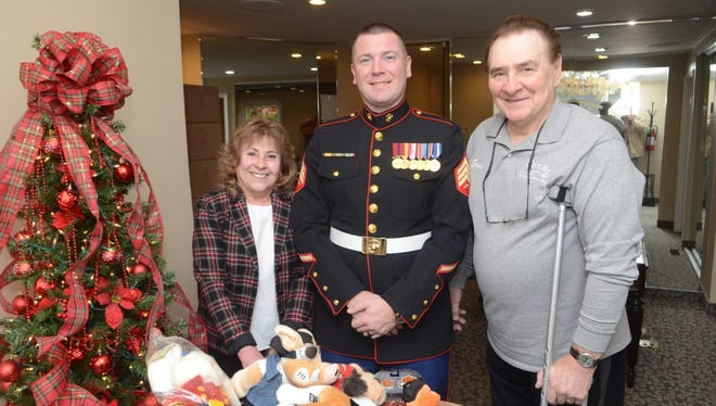Barbara and Ernie Suto with Marine Sgt. Anthony Gagliardi promoting their Toys for Tots effort.