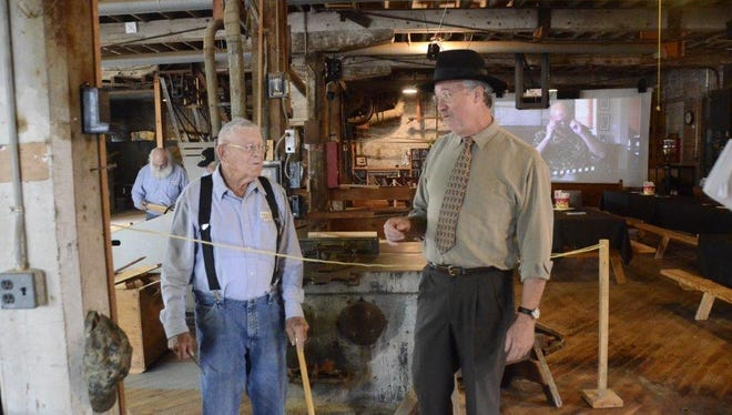 Bill Mullen, at right, with his wife April, are the owners of the Shawshank Lumberyard in Upper Sandusky.  Mullen is shown in the mill, now a museum, in his hometown in this News Journal file photo.