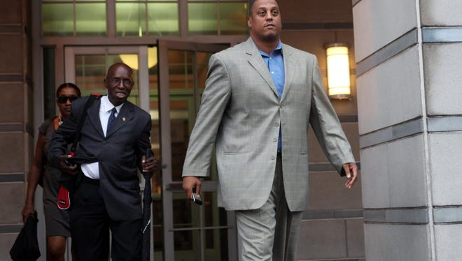 C. Tate George leaving federal court in Newark in 2011.