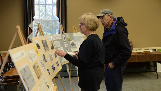 Two closter residents look at an exhibit at the 2016 Historical Society's History Day at the Harrington Park Borough Hall