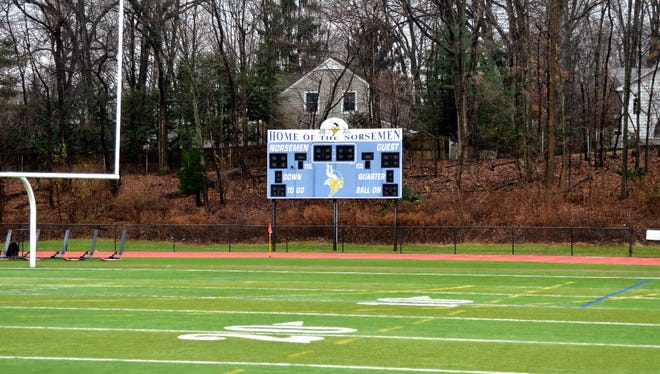 Northern Valley Regional High School at Demarest is replacing its 16-year-old scoreboard, picture above, on the school's athletic field. Local neighbors have filed a lawsuit, alleging a new sign is being built directly behind their home, 40 feet away from the location of the old scoreboard.