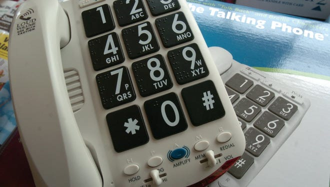 Home phone with large numbers and letters.
