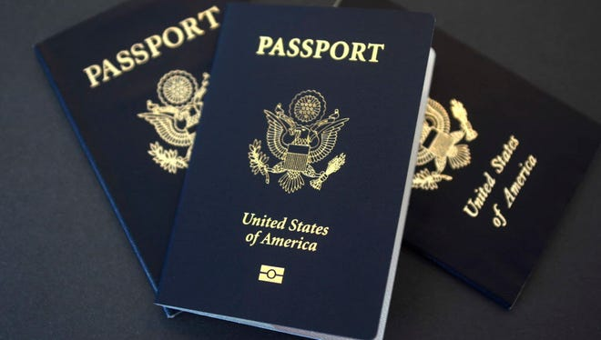 U.S. passports lie on a table in Dallas on May 9, 2017.